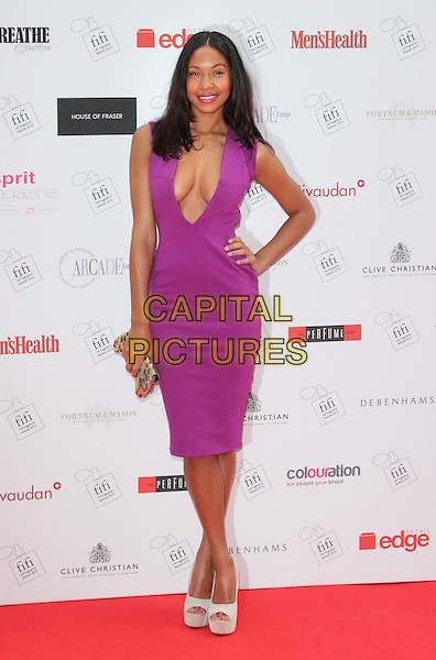 Shanika Warren-Markland.The FiFi UK Fragrance Awards 2012 at The Brewery, Chiswell Street, London, England..May 17th 2012.full length dress purple pink fuschia sleeveless plunging neckline cleavage hand on hip.CAP/ROS.©Steve Ross/Capital Pictures.