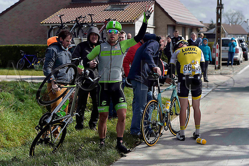 27.03.2016. Deinze, Belgium.  WIPPERT Wouter (NED) Rider of CANNONDALE PRO CYCLING TEAM is involved in a crash during the Flanders Classics UCI World Tour 78nd Gent-Wevelgem cycling race with start in Deinze and finish in Wevelgem