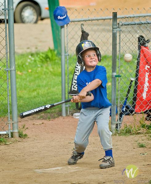 Original Little League t-ball. Child hitting ball