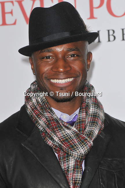 Taye Diggs -<br /> Seven Pounds Premiere at the Westwood Village Theatre In Los Angeles.