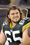 Offensive lineman Mark Tauscher #65 of the Green Bay Packers watches a replay during the preseason game against the New England Patriots at Lambeau Field on August 26, 2005 in Green Bay, Wisconsin. The Patriots beat the Packers 27-3. (Photo by David Stluka)
