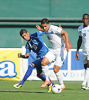 Honduras midfielder Emilio Izaguirre (7) shields the ball against El Salvador forward Nelson Bonilla (22) Honduras National Team defeated El Salvador 3-0 at RFK stadium, Saturday June 2, 2012.