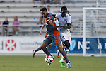 01 June 2016: Charlotte's Brian Brown (JAM) (9) fouls Carolina's Matt Watson (ENG) (8). The Carolina RailHawks hosted the Charlotte Independence at WakeMed Stadium in Cary, North Carolina in a 2016 Lamar Hunt U.S. Open Cup third round game. The RailHawks won 5-0 after extra time after regulation ended in a 0-0 tie.