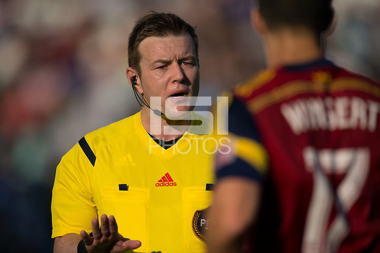 Referee Alan Kelly talks with Chris Wingert (17) of Real Salt Lake. Real Salt Lake and the Philadelphia Union played to a 2-2 tie during a Major League Soccer (MLS) match at PPL Park in Chester, PA, on April 12, 2014.