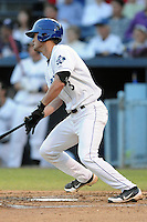 Asheville Tourists third baseman Sam Mende #8 swings at a pitch during game one of the South Atlantic League, Southern Division playoffs between the Greensboro Grasshoppers and the Asheville Tourists at McCormick Field on September 10, 2012 in Asheville, North Carolina . The Grasshoppers defeated the Tourists 6-3. (Tony Farlow/Four Seam Images).