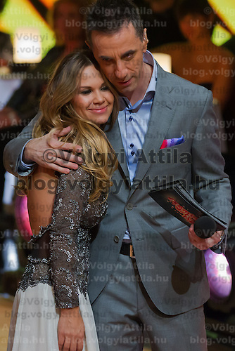 "Hajnalka Majros ""Dundika"" and Andras Csonka ""Pici"" hug each other in the live broadcast celebrity dancing talent show Saturday Night Fever by Hungarian television company RTL II in Budapest, Hungary on March 16, 2013. ATTILA VOLGYI"