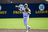 Michigan Wolverines second baseman Hector Gutierrez (24) makes a throw to first base against the Central Michigan Chippewas on March 29, 2016 at Ray Fisher Stadium in Ann Arbor, Michigan. Michigan defeated Central Michigan 9-7. (Andrew Woolley/Four Seam Images)