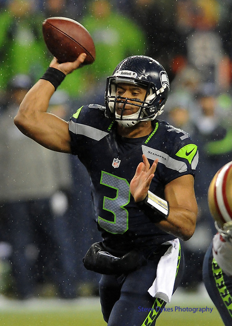 SEATTLE, WA. - DECEMBER 23: Quarterback Russell Wilson #3 of the Seattle Seahawks pass the ball for a touchdown during the first quarter  of the game against the San Francisco 49ers at CenturyLink Field on December 23, 2012 in Seattle,Wa. (Photo by Steve Dykes/Getty Images) *** Local Caption *** Russell Wilson
