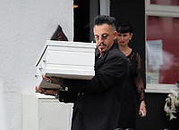 "COPY BY TOM BEDFORD<br /> Pictured: Paul Black carries the white coffin of his daughter Pearl from the family home in Merthyr Tydfil, Wales, UK. Friday 18 August 2017<br /> Re: The funeral of a toddler who died after a parked Range Rover's brakes failed and it hit a garden wall which fell on top of her will be held today at Jerusalem Baptist Chapel in Merthyr Tydfil.<br /> One year old Pearl Melody Black and her eight-month-old brother were taken to hospital after the incident in south Wales.<br /> Pearl's family, father Paul who is The Voice contestant and mum Gemma have said she was ""as bright as the stars""."