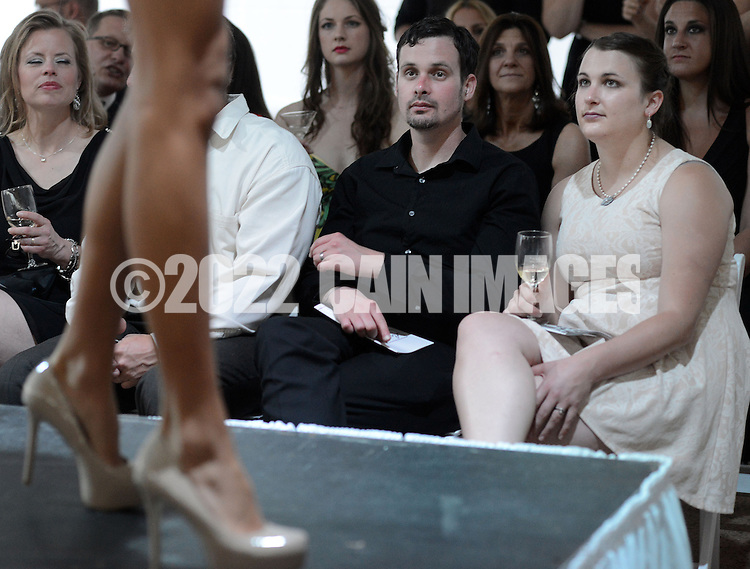 DOYLESTOWN, PA - JUNE 06: Matthew Carroll (2nd from right) and Nicole Hatch (R) watch a model on the runway during the Canines on the Catwalk fashion show June 6, 2014 at the Michener Museum in Doylestown, Pennsylvania. Canines on the Catwalk is a fashion show coupling professional models, high-end clothes and dogs. The program benefits animal rescue  (Photo by William Thomas Cain/Cain Images)