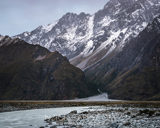 Dusk over Gorilla Stream and Hooker River with fresh snow on Burnett Mountains in background, Aoraki Mount Cook National Park, UNESCO World Heritage Area,  Mackenzie Country, New Zealand, NZ