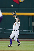 LSU Tiger outfielder Raph Rhymes (4) makes a catch during Game 4 of the 2013 Men's College World Series against the UCLA Bruins on June 16, 2013 at TD Ameritrade Park in Omaha, Nebraska. UCLA defeated LSU 2-1. (Andrew Woolley/Four Seam Images)