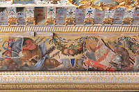 Frieze with armour, shields, flags and fruit garlands at the top of the walls of the Guard Room, attributed to Ruggerio de Ruggieri, c. 1570, rearanged in Louis XIII's day, Chateau de Fontainebleau, France. The Palace of Fontainebleau is one of the largest French royal palaces and was begun in the early 16th century for Francois I. It was listed as a UNESCO World Heritage Site in 1981. Picture by Manuel Cohen