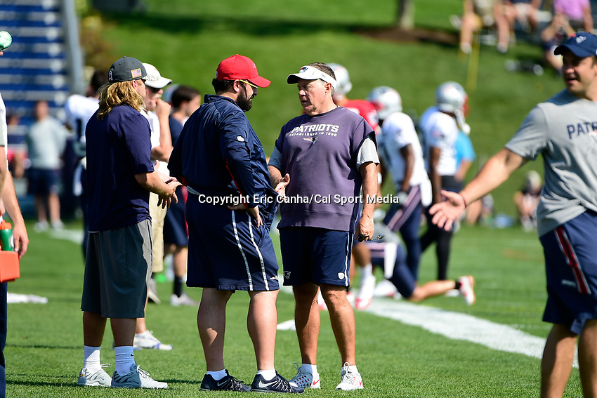 August 1, 2017: New England Patriots head coach Bill Belichick (right) talks to defensive coordinator Matt Patricia (red hat) and safeties coach Steve Belichick (gray hat) at the New England Patriots training camp held at Gillette Stadium, in Foxborough, Massachusetts. Eric Canha/CSM