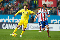 Atletico de Madrid´s Tiago Cardoso and Villarreal´s Luciano Dario Vietto during 2014-15 La Liga match between Atletico de Madrid and Villarreal at Vicente Calderon stadium in Madrid, Spain. December 14, 2014. (ALTERPHOTOS/Luis Fernandez) /NortePhoto
