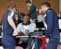 AFC Wimbledon manager, Neal Ardley chats with former team mate Marcus Gayle during the Carabao Cup match between AFC Wimbledon and Brentford at the Cherry Red Records Stadium, Kingston, England on 8 August 2017. Photo by Carlton Myrie.