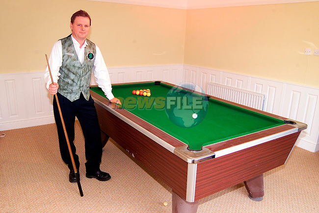 Matt Stephenson with the pool table in his house..Picture: Paul Mohan/Newsfile