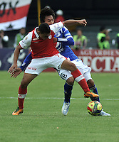 "BOGOTA, COLOMBIA - ENERO 27: Luis C. Arias (Izq.) delantero de Independiente Santa Fe disputa el balón con Rafael Robayo (Der.) mediocampista de Millonarios un partido por la final de la SuperLiga de Campeones en el estadio Nemesio Camacho ""El Campín"" en la ciudad de Bogotá, enero 27 de 2013. (Foto: VizzorImage / Luis Ramírez / Staff). Luis C. Arias (L) foward of Independiente Santa Fe fight for the ball with Rafael Robayo (R), midfielder  of Millonarios during a match for the final of the Champions Super League at the Nemesio Camacho  ""El Campin"" stadium in Bogota city, on January 27, 2013 (Photo: VizzorImage / Luis Ramírez / Staff)"