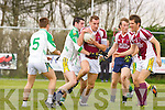 Sean O'Sullivan Cromane is held up by Martin Mahony Ballydonohue during their league game in Cromane on Sunday