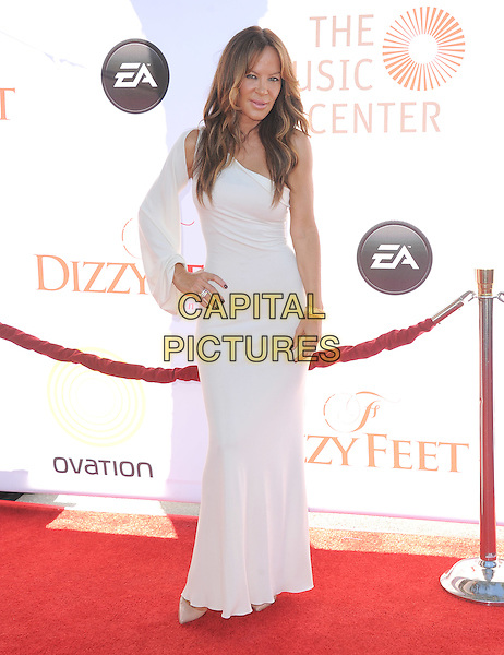 Robin Antin .attends the Dizzy Feet Foundation's Celebration of Dance Gala held at The Dorothy Chandler Pavilion at The Music Center in Los Angeles, California, USA,  July 28th 2012..full length long maxi dress hand on hip sleeve white one shoulder                                                                  .CAP/RKE/DVS.©DVS/RockinExposures/Capital Pictures.