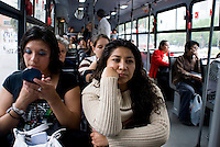 "A comuter puts on her make-up on Mexico City's public transportation's ""Women Only"" bus Mexico D.F., Mexico.  Wednesday, April 30, 2008"