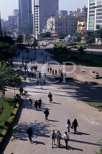 Sao Paulo, Brazil. Pedestrians walking in the Vale do Anhangabau city centre park.