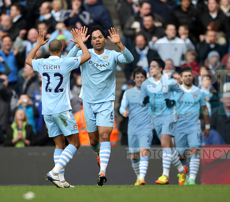 Manchester Citys Joleon Lescott celebrates scoring his sides second goal..Manchester City v Tottenham Hotspur in the the Barclays Premier League, at the Etihad Stadium, Manchester. 22nd January 2012.--------------------.Sportimage +44 7980659747.picturedesk@sportimage.co.uk.http://www.sportimage.co.uk/.Editorial use only. Maximum 45 images during a match. No video emulation or promotion as 'live'. No use in games, competitions, merchandise, betting or single club/player services. No use with unofficial audio, video, data, fixtures or club/league logos.