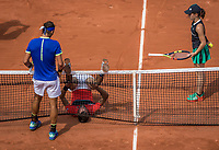 Paris, France, 29 May, 2017, Tennis, French Open, Roland Garros, Benoit Paire (FRA) falls and Rafael Nadal (ESP) comes to check it out<br /> Photo: Henk Koster/tennisimages.com