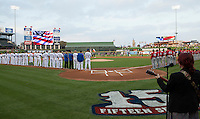 Singer Carolyn Wonderland sings the National Anthem before the Pacific Coast League Opening Day game between the Round Rock Express and the Oklahoma City Redhawks on April 3, 2014 at the Dell Diamond in Round Rock, Texas. The Redhawks defeated the Express 7-6 in the season opener for both teams. (Andrew Woolley/Four Seam Images)