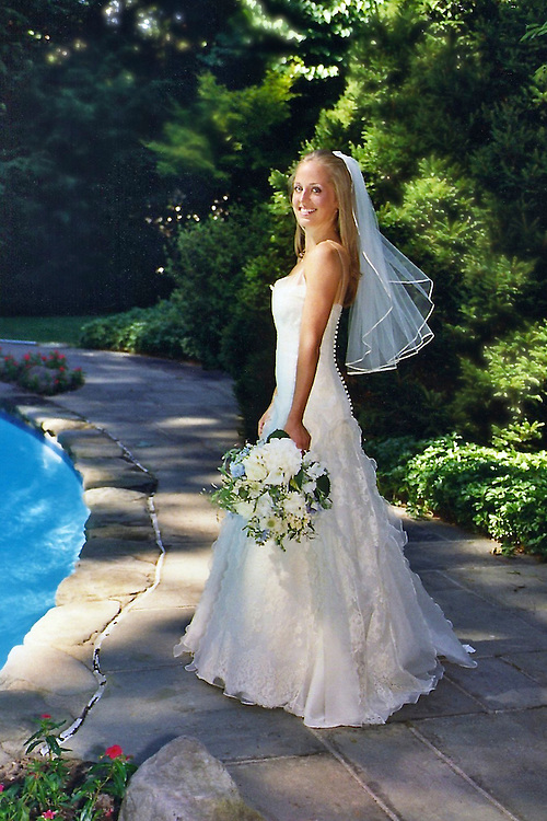 Full length portrait of a bride by the side of a pool in Greenwich, Ct.