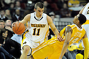 Tone Boyle of the University of Wisconsin Milwaukee knocks down Valparaiso's Howard Little during the semifinal Horizon League Championship game in Milwaukee on Saturday, March 5, 2011. | Ernie Mastroianni~For Sun-Times Media