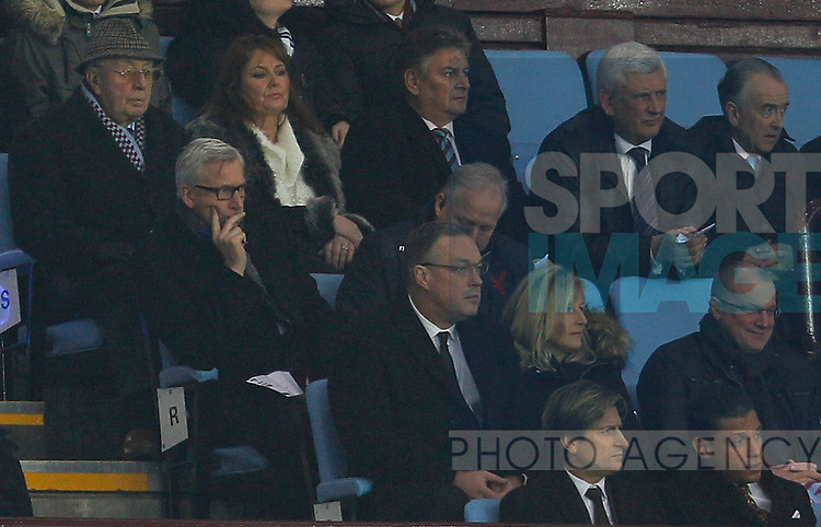 Alan Pardew looks on from the directors box at Villa Park in front of former Villa chairman Doug Ellis and behind Palace chairman Steve Parrish (front row second from right) - Barclays Premiership Football - Aston Villa v Crystal Palace - Villa Park  Birmingham - Season 14/15 - 01/01/2015 <br /> Photo: Malcolm Couzens/Sportimage