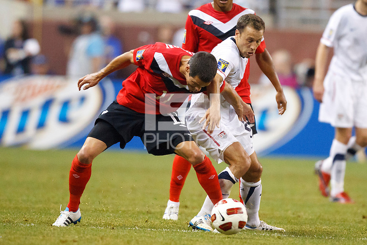 7 June 2011: Canada midfielder Josh Simpson (11) and USA Men's National Team defender Steve Cherundolo (6) go for the ball during the CONCACAF soccer match between USA MNT and Canada MNT at Ford Field Detroit, Michigan. USA won 2-0.