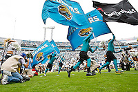 October 09, 2011:  Jacksonville Jaguars team and flag bearers run out on the field prior to the start of action between the Jacksonville Jaguars and the Cincinnati Bengals played at EverBank Field in Jacksonville, Florida.  ........