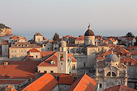 View over the rooftops of the medieval walled city with the Bell Tower, Cathedral and St Blaise Church, Dubrovnik, Croatia. The city developed as an important port in the 15th and 16th centuries and has had a multicultural history, allied to the Romans, Ostrogoths, Byzantines, Ancona, Hungary and the Ottomans. In 1979 the city was listed as a UNESCO World Heritage Site. Picture by Manuel Cohen