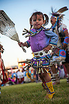 Abie Runs Above, dances in her jingle dress during an afternoon Grand Entry at Crow Fair