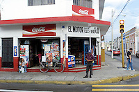 Corner store in red and white in Merida, Mexico.