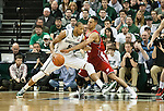 Michigan State Spartans forward Adreian Payne tries to drive to the basket while defended by Wisconsin Badgers forward Ryan Evans during a Big Ten basketball game at the Breslin Center in East Lansing, MI on March 7, 2013. (Photo by Bob Campbell)