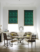 Green cotton blinds are the focus of this otherwise tranquil living room