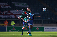 Jakub Sokolik of Plymouth Argyle heads clear of Adebayo Akinfenwa of Wycombe Wanderers during the Sky Bet League 2 match between Wycombe Wanderers and Plymouth Argyle at Adams Park, High Wycombe, England on 14 March 2017. Photo by Kevin Prescod / PRiME Media Images.