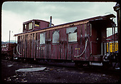 3/4 view old deteriorating caboose.<br /> D&amp;RGW