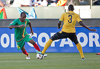 CARSON, CA – June 6, 2011: Greneda player Anthony Straker (15) attempts to move past Jamaican Dicoy Williams (3) during the match between Grenada and Jamaica at the Home Depot Center in Carson, California. Final score Jamaica 4 and Grenada 0.