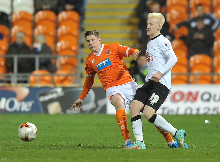 Blackpool's John Lundstram is beaten to the ball by Derby County's Will Hughes<br /> <br /> Photographer Dave Howarth/CameraSport<br /> <br /> Football - The Football League Sky Bet Championship - Blackpool v Derby County - Tuesday 21st October 2014 - Bloomfield Road - Blackpool<br /> <br /> &copy; CameraSport - 43 Linden Ave. Countesthorpe. Leicester. England. LE8 5PG - Tel: +44 (0) 116 277 4147 - admin@camerasport.com - www.camerasport.com