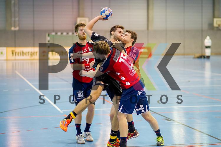 Sebastian Gress (25, HC Elbflorenz 2006), am Ball wird von Tom Warmke (15, TV Huettenberg), und Moritz Lambrecht (7, TV Huettenberg), geblockt im Spiel HC Elbflorenz - TV Huettenberg.<br /> <br /> Foto &copy; PIX-Sportfotos *** Foto ist honorarpflichtig! *** Auf Anfrage in hoeherer Qualitaet/Aufloesung. Belegexemplar erbeten. Veroeffentlichung ausschliesslich fuer journalistisch-publizistische Zwecke. For editorial use only.