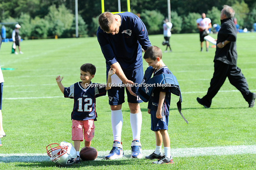 August 15, 2013 - Foxborough, Massachusetts, U.S. - New England Patriots quarterback Tom Brady (12) put his pads on his son Jack at the end of the New England Patriots training camp at Gillette Stadium in Foxborough Massachusetts.   Eric Canha/CSM