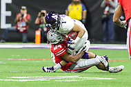 Indianapolis, IN - December 1, 2018: Northwestern Wildcats running back Chad Hanaoka (1) is tackled by Ohio State Buckeyes cornerback Shaun Wade (24) during the Big Ten championship game between Northwestern  and Ohio State at Lucas Oil Stadium in Indianapolis, IN.   (Photo by Elliott Brown/Media Images International)