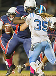 Lawndale, CA 10/14/16 - Tyler Jackson (Leuzinger #74) and Seth Sickle (North Torrance #35) in action during the North Torrance vs Leuzinger CIF League football game.