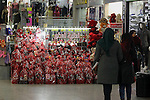 Palestinian vendors display red teddy bears, red ballons and pillows on Valentine's day in the West Bank city of Hebron on February 14, 2017. Valentine's Day is increasingly popular in the region as people have taken up the custom of giving flowers, cards, chocolates and gifts to sweethearts to celebrate the occasion. Photo by Wisam Hashlamoun
