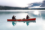 Morning on Maligne Lake, Jasper National Park, Alberta, Canada.  Trent and Linda Enzsol paddling Wenonah Escape.