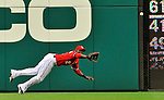 19 June 2011: Washington Nationals' outfielder Roger Bernadina dives for a Derrek Lee drive, but comes up short during a game against the Baltimore Orioles in a Father's Day matchup at Nationals Park in Washington, District of Columbia. The Orioles defeated the Nationals 7-4 in inter-league play, ending Washington's 8-game winning streak. Mandatory Credit: Ed Wolfstein Photo